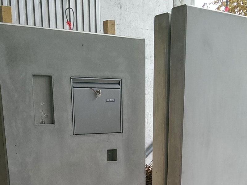 L-Wandteile in Sichtbeton mit Aussparungen